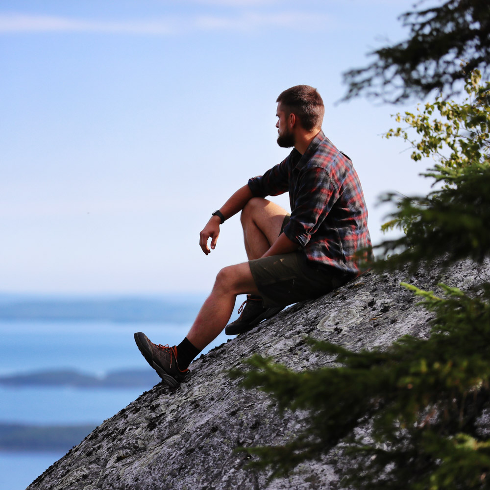 Scenery photo of a man on a rock